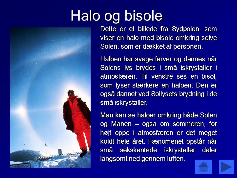 Halo og bisole Dette er et billede fra Sydpolen, som viser en halo med bisole omkring selve Solen, som er dækket af personen.