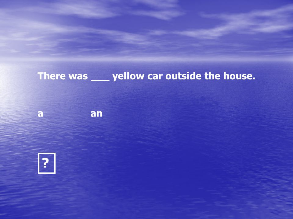 There was ___ yellow car outside the house.
